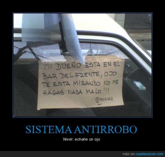 antirrobo,cartel,coche,mirar