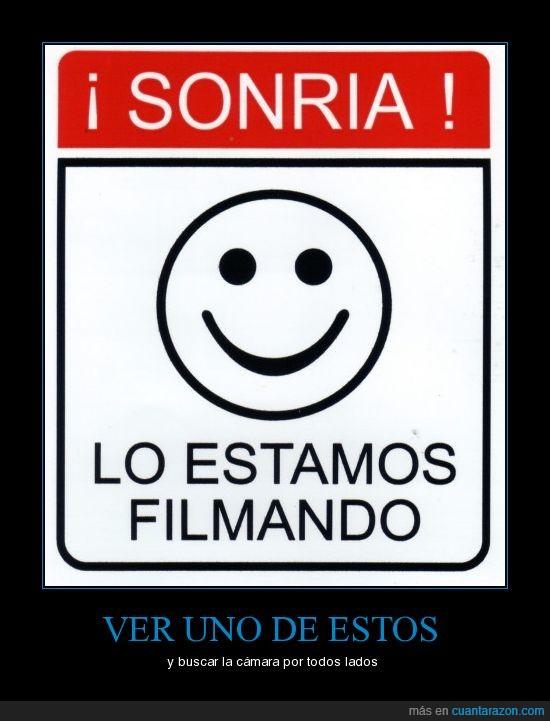 camara,cartel,filmando,seguridad,sonria