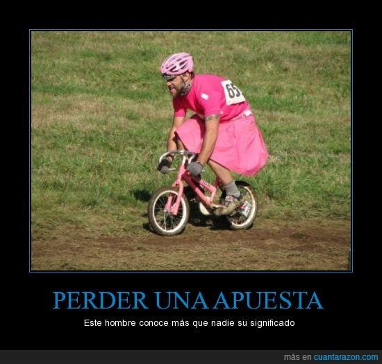 bici rosa,hombre,perder apuesta.,vestirse de rosa