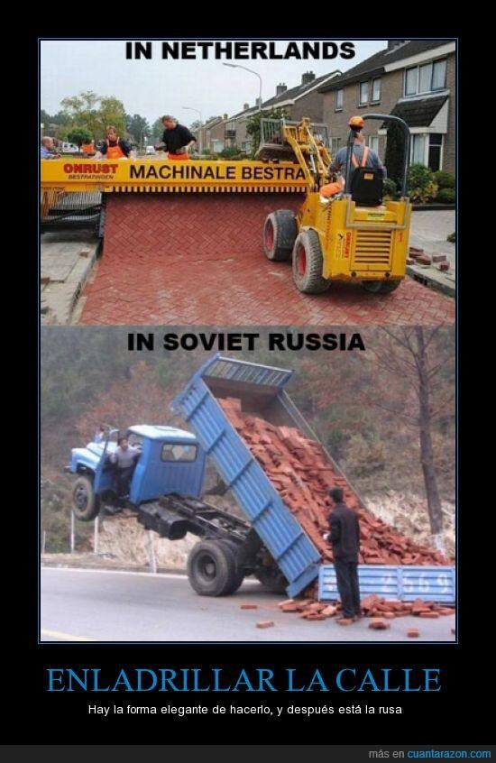 calle,ladrillos,máquina,obreros