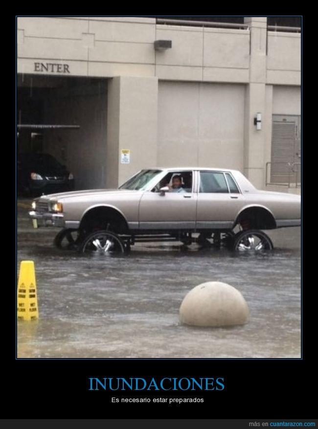 buena idea,carro,hombre,inundaciones,llantas,lluvia