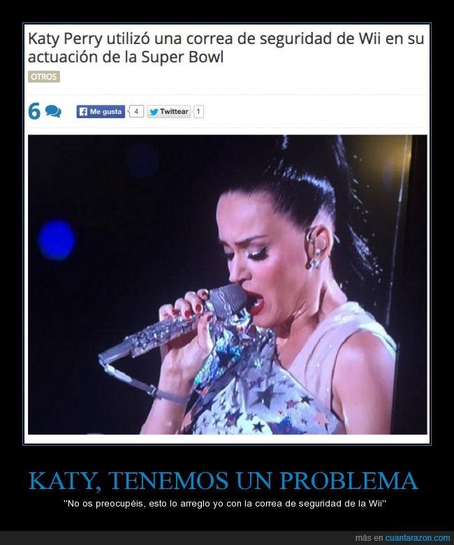 actuación,caer,cantar,descanso,Katy Perry,mando,microfono,nintendo,seguridad,strap,Superbowl,wii