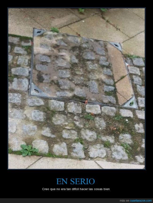 alcantarilla,colocar,mal,piedra,suelo,tapa,trabajo,uno