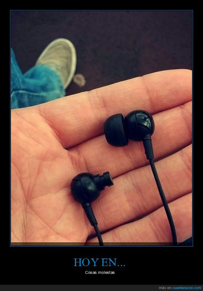 auriculares,goma,mano