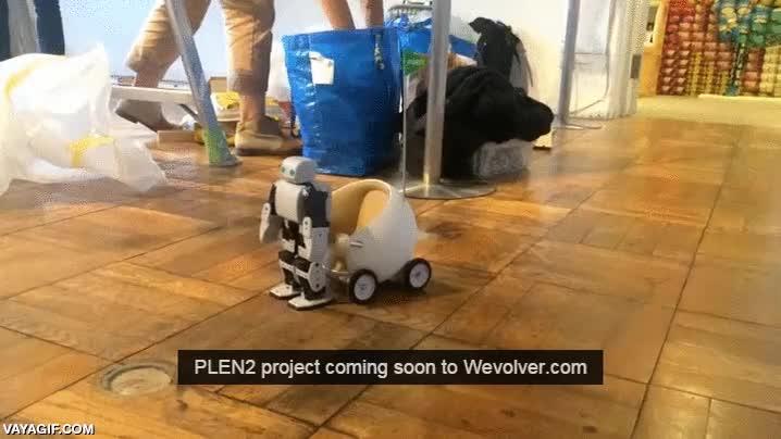 Enlace a Un pequeño robotito impreso en 3D montado en su cochecito impreso en 3D
