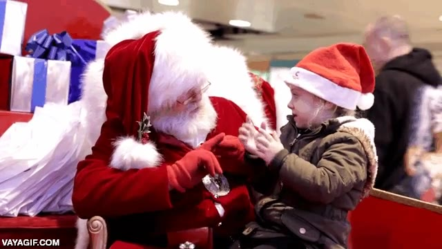 Enlace a Este Papá Noel de centro comercial no tiene problemas para entenderse con una niña sorda
