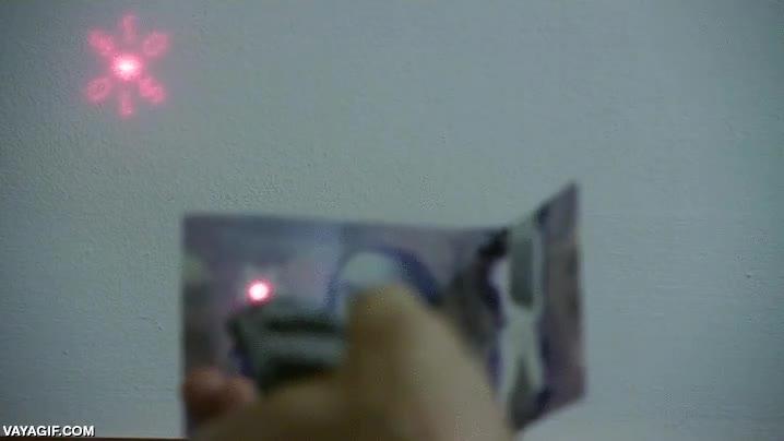 Enlace a Si apuntas un láser a través de la hoja de arce de los billetes canadienses, verás esto
