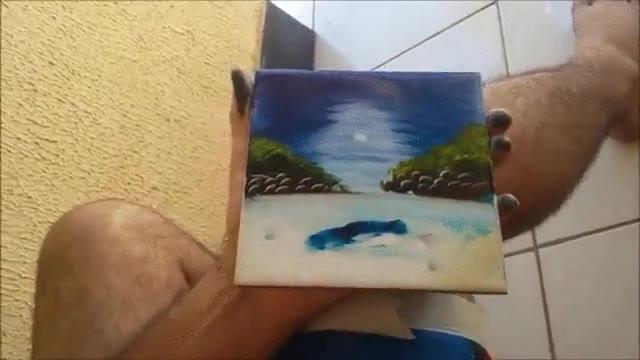 Enlace a Bob Ross y su forma de hacer arte pintando con los dedos
