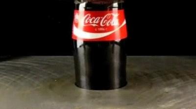Enlace a Prensa hidraulica VS Botella de Cocacola