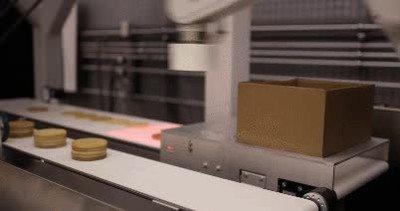 Enlace a Robots preparando los paquetes de gofres que luego te comes