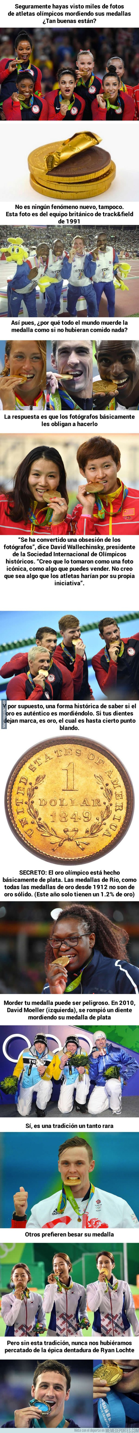 898677 - El motivo por el cual los atletas muerden sus medallas