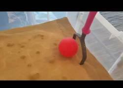 Enlace a Creando arena líquida