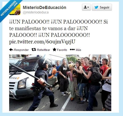 manifestantes,palo,policías