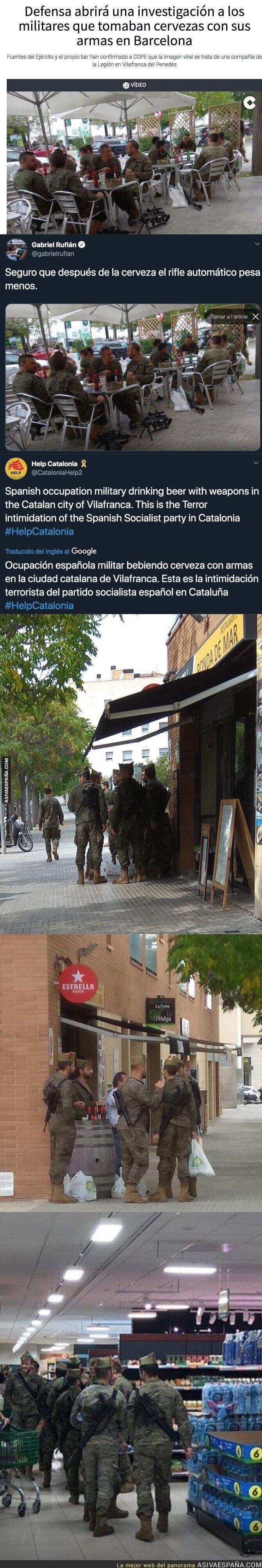 122367 - Lío monumental por esta foto de varios militares tomando cerveza por Catalunya con armas en el suelo