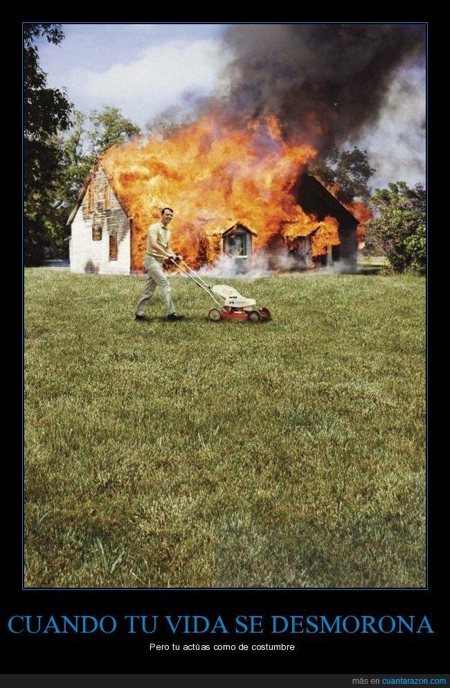 ardiendo,casa,cortando el césped