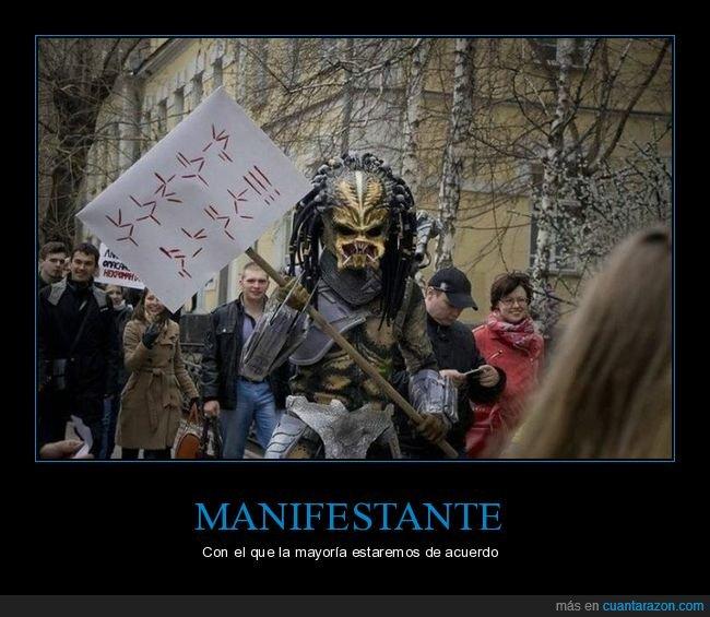 cosplay,depredador,manifestación,pancarta