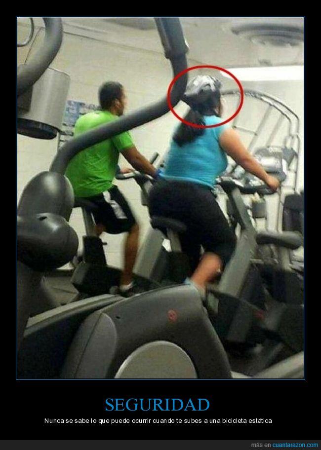 bicicleta estática,casco,gimnasio