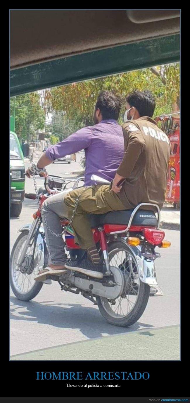 arrestado,comisaría,moto,policía