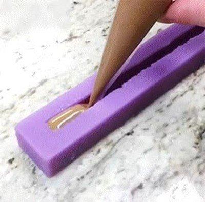 Enlace a Así se hace un cigarrillo de chocolate