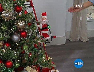 Enlace a Han creado un Papa Noel que sube por las escaleras del árbol de navidad