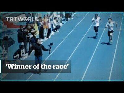 Un hombre-cámara corre más deprisa que los propios participantes de la carrera que filma