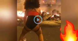 Enlace a La forma de protestar de esta chica es perreando justo delante de contenedores ardiendo... No sé si es efectivo, curioso un rato