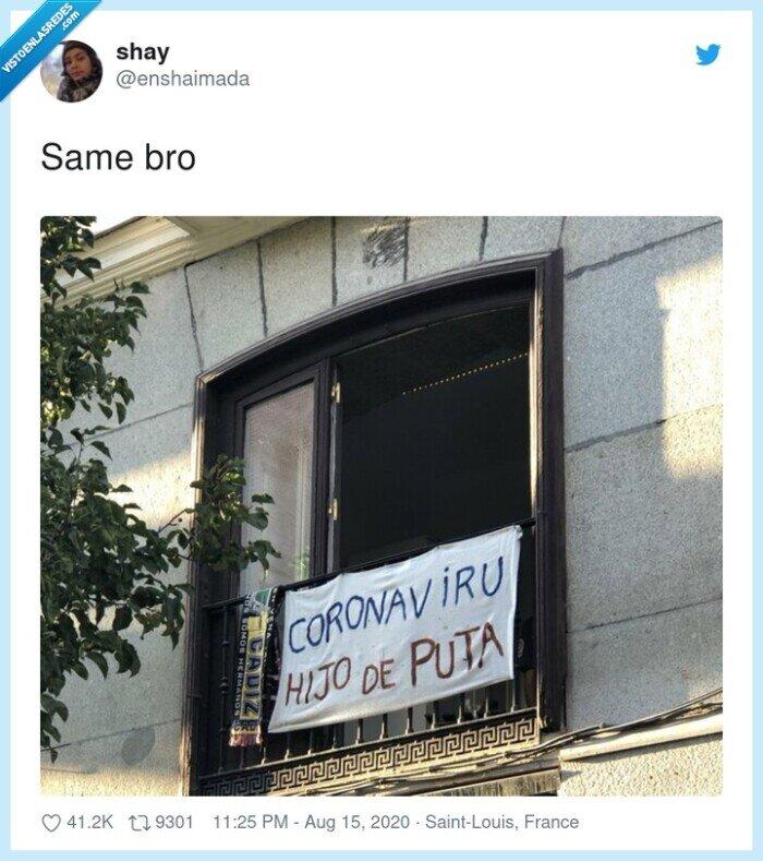 balcón,coronavirus,pancarta