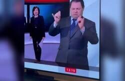 Enlace a La tremenda manera de un traductor de lengua de signos de representar una 'rave' en televisión